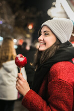 Beautiful Woman Eating Caramelised Toffee Apple