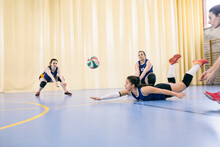 Competitive Female Volleyball Team Failing Blocking Ball While Tournament In Madrid, Spain.