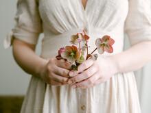 Woman Holding Hellebores Flowe...