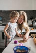 Little Girl Baking Cookies Wit...