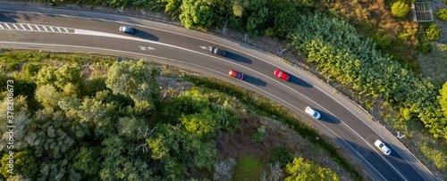 Traffic on a spanish road with cars driving seen from above aerial view