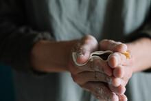 Closeup Of Man's Hands Assembling Homemade Dumplings