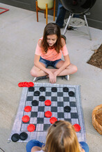 2 Girls Playing Outdoor Checkers