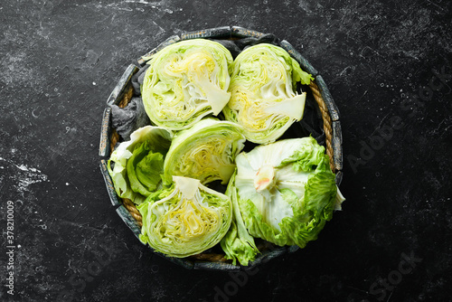 Fototapeta Iceberg lettuce in a wooden box. Top view. Free copy space. obraz