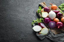 Colored Ripe Onions On Wooden ...