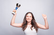 Cheerful young woman holding cup award, celebrating success