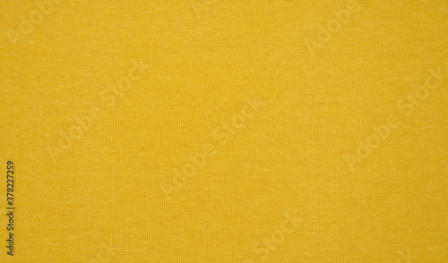 Fotografija fabric texture yellow background.