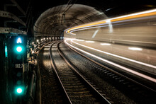 Railway Tunnel With Train In Motion