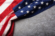 America United States flag, memorial remembrance and thank you of hero, studio shot with copy space concrete board background, USA holiday Veterans or Independence day concept