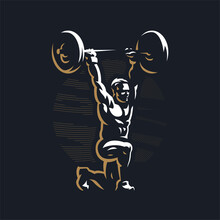 Fitness Man Raises The Barbell.