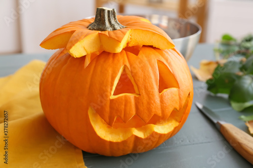 Carved Halloween pumpkin on table Canvas Print