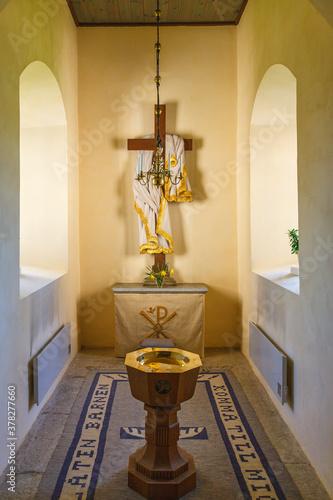 Billede på lærred Church interior with a baptismal font and altar