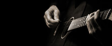 Playing An Acoustic Guitar. Guitarist Hands And Guitar Close Up. Black And White. Copy Space