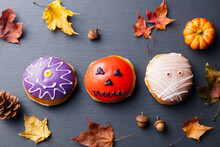 Donuts With Halloween Decoration, Icing On Black Slate Background. Top View.