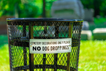 Wire Trash Can In Cemetery Wit...