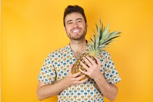 Young Man Holding Pineapple We...