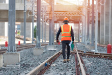 Engineer Walking And Check Track Work On Railways. People Walk On Railway .