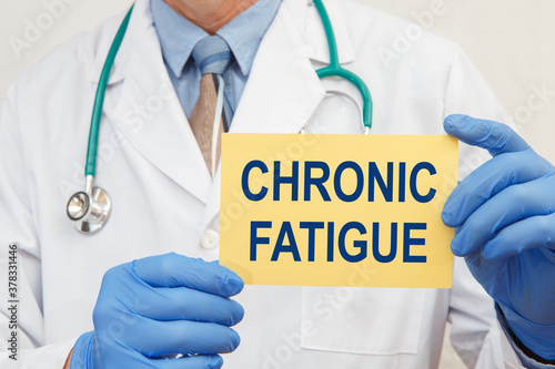 Photo Doctor holding sign with text CHRONIC FATIGUE