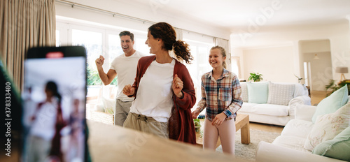 Family making dancing video on smart phone Canvas
