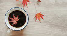 Coffee And Autumn Leaves On Th...