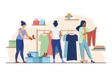 Women Choosing Clothes In Appa...
