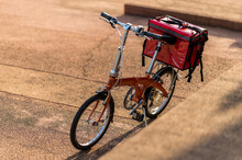 A Red Bag Placed On A Bicycle ...