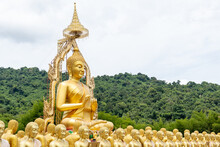 Golden Buddha Statue On A Mountain In The Green Forest.