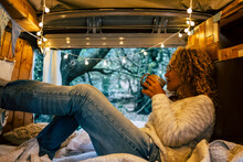 Relaxed Adult Woman Inside A Vintage Wooden Van Enjoy The Natoure Outdoor And The Travel Lifestyle - Tourist And Vehicle Camping Life With Forest View Outside - Wanderlust And Van Life Modern Concept