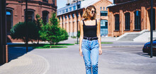 Stylish Young Woman Strolling Along Street