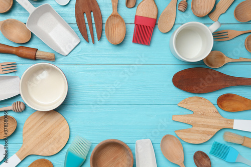 Frame made with modern cooking utensils on light blue wooden table, flat lay Fototapet