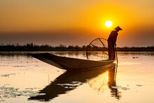 Myanmar, Shan State, Silhouette Of Traditional Intha Fisherman On Inle Lake At Sunset