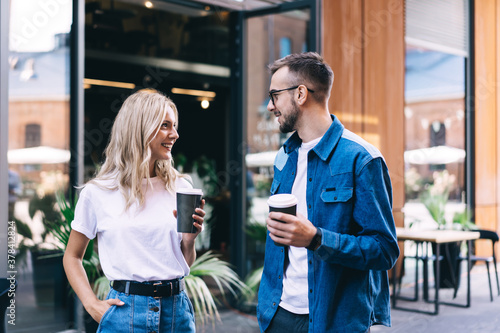 Fotografía Happy young couple with coffee spending time together in street
