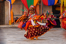 Bumthang In Bhutan At The Yearly  Festival In The Monastery Of Jakar. A Monk Is Wearing  A Colourful Traditional Mask.