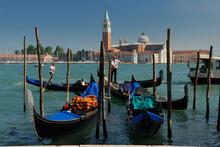 Gondoliers On Giudecca Canal In Front Of San Giorgio Maggiore In Venice