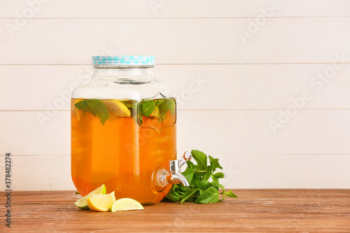 Fototapeta Jar of fresh ice tea on table obraz