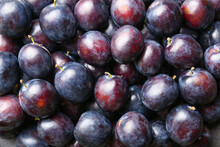 Many Ripe Plums As Background