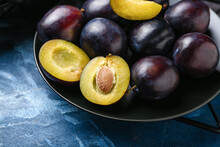 Plate With Ripe Plums On Color...