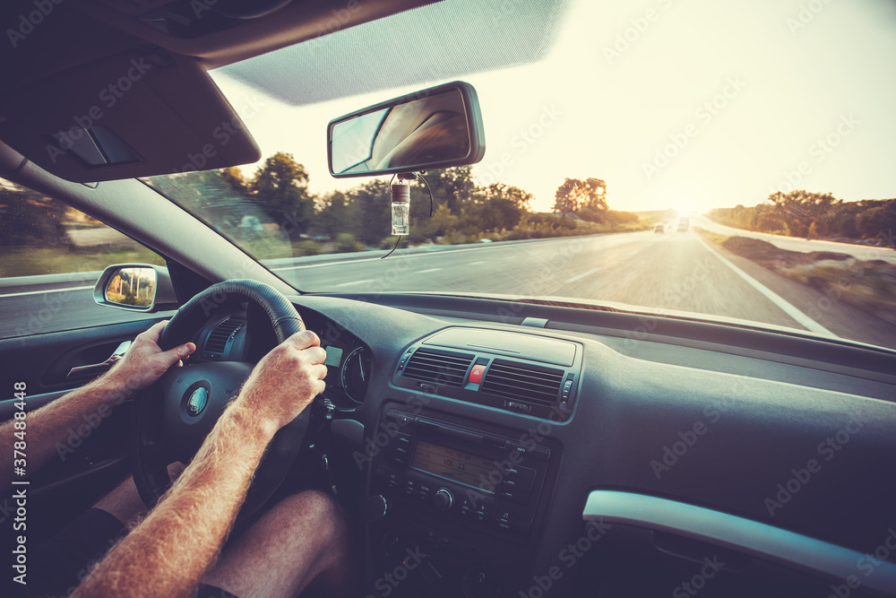 Fototapeta Car dashboard and steering wheel whith hand inside of car. Travel concepte