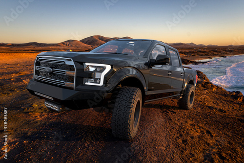 Ford F-150 Raptor in the wilderness over the ocean at sunset