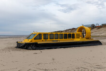 Yellow Hovercraft On The Sand Beach Close Up