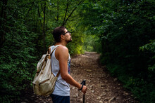 Portrait Of A Man Hiker Walking On The Trail In The Woods.