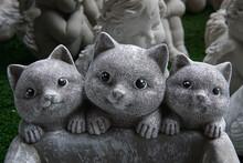 Sculpture Of A Cat In The Garden
