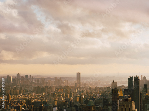 Clouds over sunny cityscape, New York City, New York, USA  - 378509217