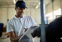 Happy Car Mechanic Taking Note...
