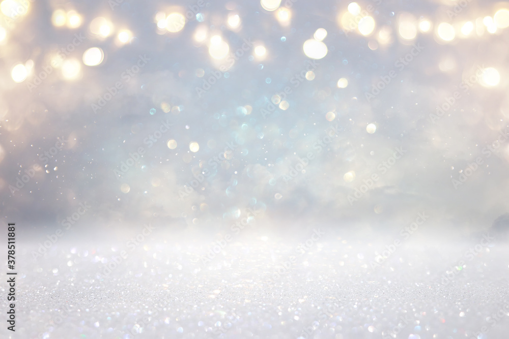 Fototapeta glitter vintage lights background. silver, gold and white. de-focused