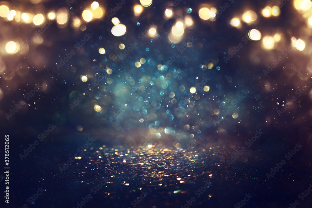 Fototapeta background of abstract glitter lights. gold, blue and black. de focused
