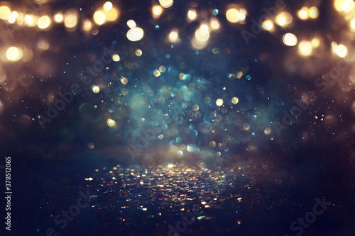 Fototapeta background of abstract glitter lights. gold, blue and black. de focused obraz