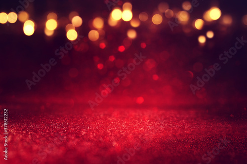 background of abstract red, gold and black glitter lights. defocused - 378512232
