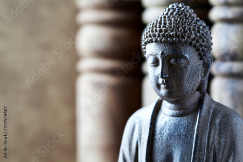 Fototapeta Meditating Buddha Statue on bright background. Close up.  obraz
