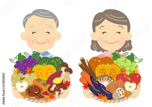 Fototapeta 秋野菜と果物を持つ、農家の老夫婦